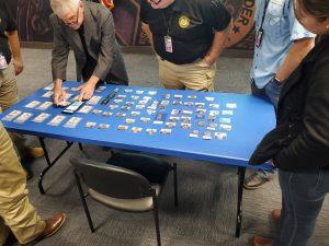 Doug Davis setting up counterfeits display